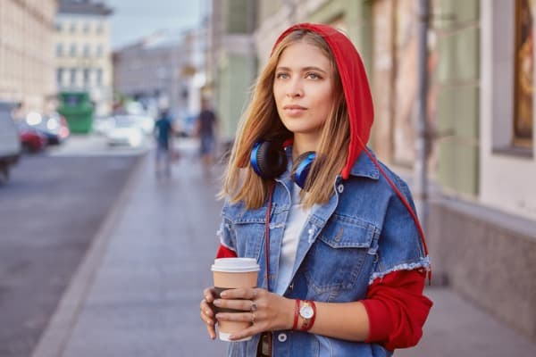 beautiful young lady drinks coffee outdoor