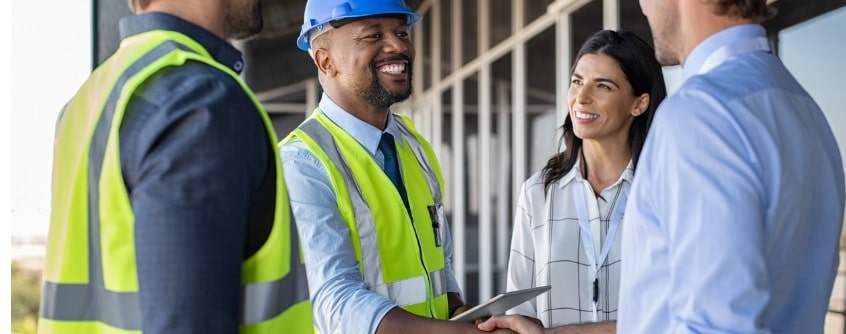 engineer and businessman handshake at construction site picture id1189913170 1