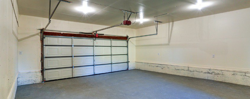 interior of an empty clean garage with closed door