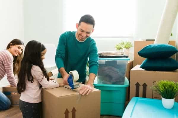 little girl helping her parents to pack