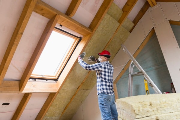 man-installing-thermal-roof-insulation-layer