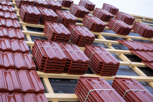 roof under construction with stacks of roof tiles