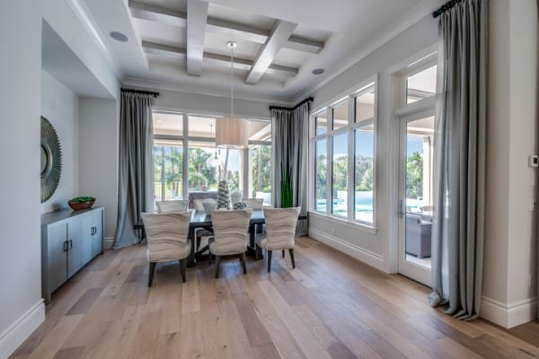 spacious-dining-room-with-hardwood-floors-and-coffered-ceiling